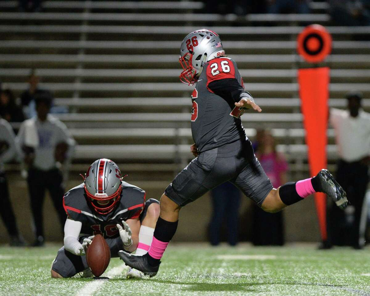 Sergio Rubio (26) of Travis kicks a field goal during the second quarter of a 6A Region III District 20 football game between the Ridge Point Panthers and Travis Tigers on Thursday, October 17, 2019 at Mercer Stadium, Sugar Land, TX.