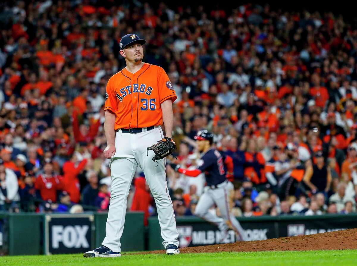 Houston Astros relief pitcher Will Harris (36) reacts after giving up a two-run home run to Washington Nationals designated hitter Howie Kendrick (47) that gives the Nationals a 3-1 lead during the seventh inning of Game 7 of the World Series at Minute Maid Park on Wednesday, Oct. 30, 2019, in Houston.