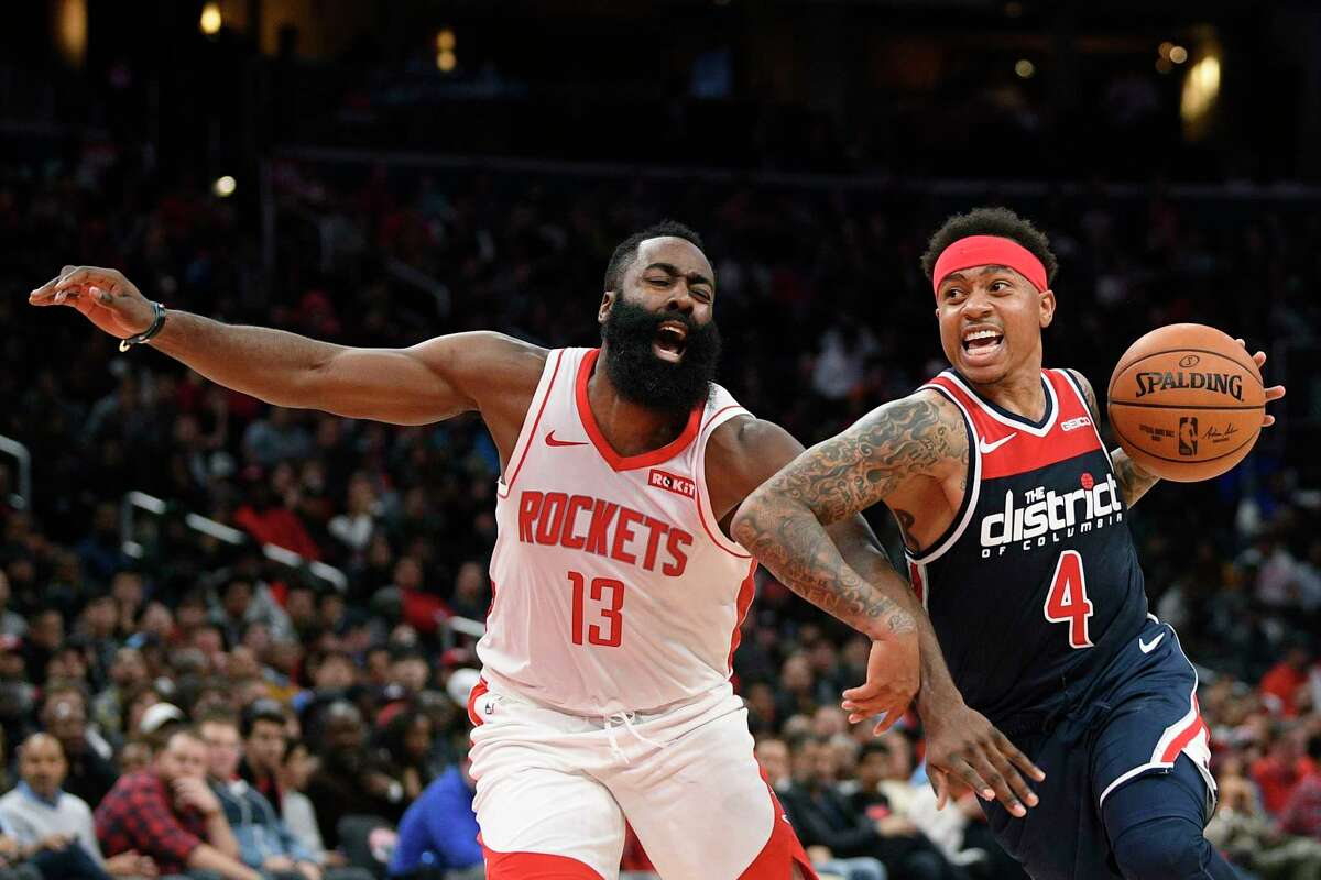 Washington Wizards guard Isaiah Thomas (4) drives to the basket against Houston Rockets guard James Harden (13) during the second half of an NBA basketball game Wednesday, Oct. 30, 2019, in Washington. (AP Photo/Nick Wass)