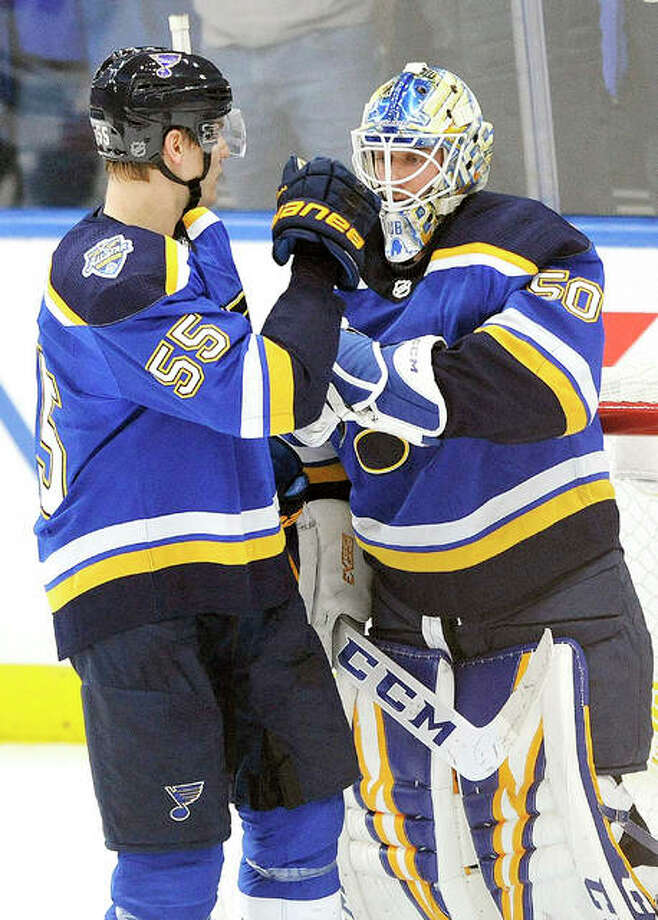The Blues' Jordan Binnington (50) is congratulated by Colton Parayko (55) after the team's 2-1 victory over the Minnesota Wild Wednesday night in St. Louis. Photo: AP Photo