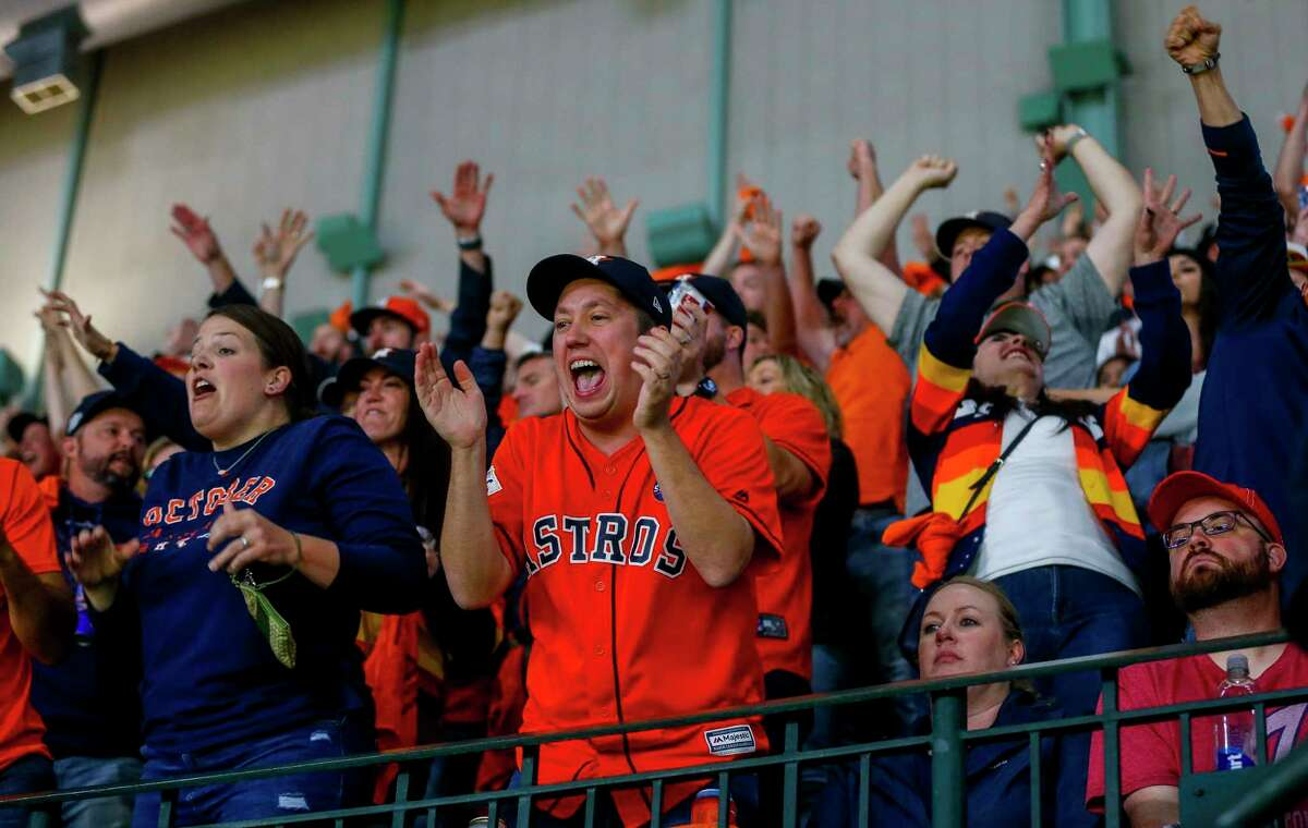 Astros fans cheer during Game 7 of the World Series at Minute Maid Park on Wednesday, Oct. 30, 2019, in Houston.