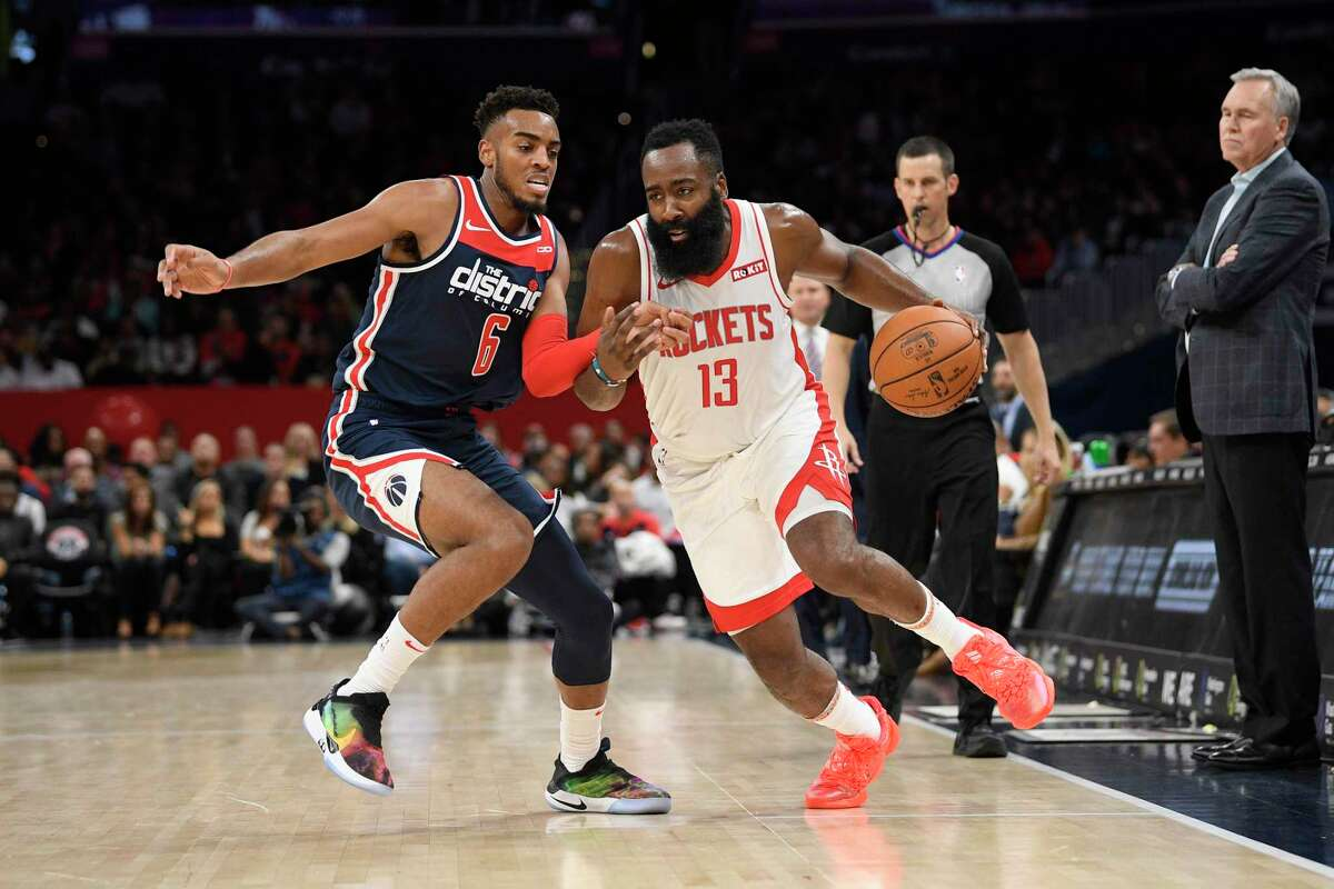 James Harden drives past Washington's Troy Brown Jr. on his way to a 59-point night.