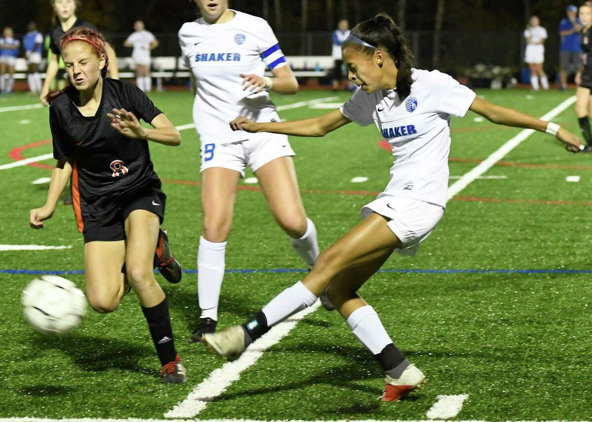 Shaker's Mayah Wheeler kicks the ball from Bethlehem's Casey Holstein during their Class AA semifinal match on Wednesday, Oct. 30, 2019, in Mechanicville, N.Y. (Jenn March, Special to the Times Union)
