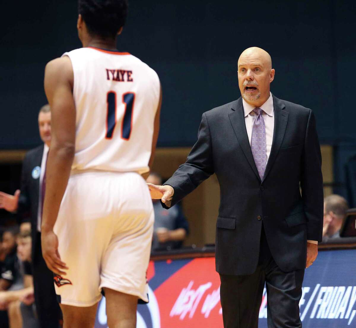 UTSA basketball coach Steve Henson talks with his player Adokiye Iyaye (11) during the game against Texas A&M International in an exhibition game on Wednesday, Oct. 30, 2019 at the Convocation Center. (Kin Man Hui/San Antonio Express-News)