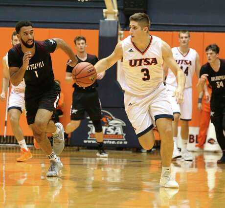 UTSA's Byron Frohnen (03) pushes the ball up court against Texas A&M International's Adrian Nosa (01) during an exhibition game on Wednesday, Oct. 30, 2019 at the Convocation Center. (Kin Man Hui/San Antonio Express-News)