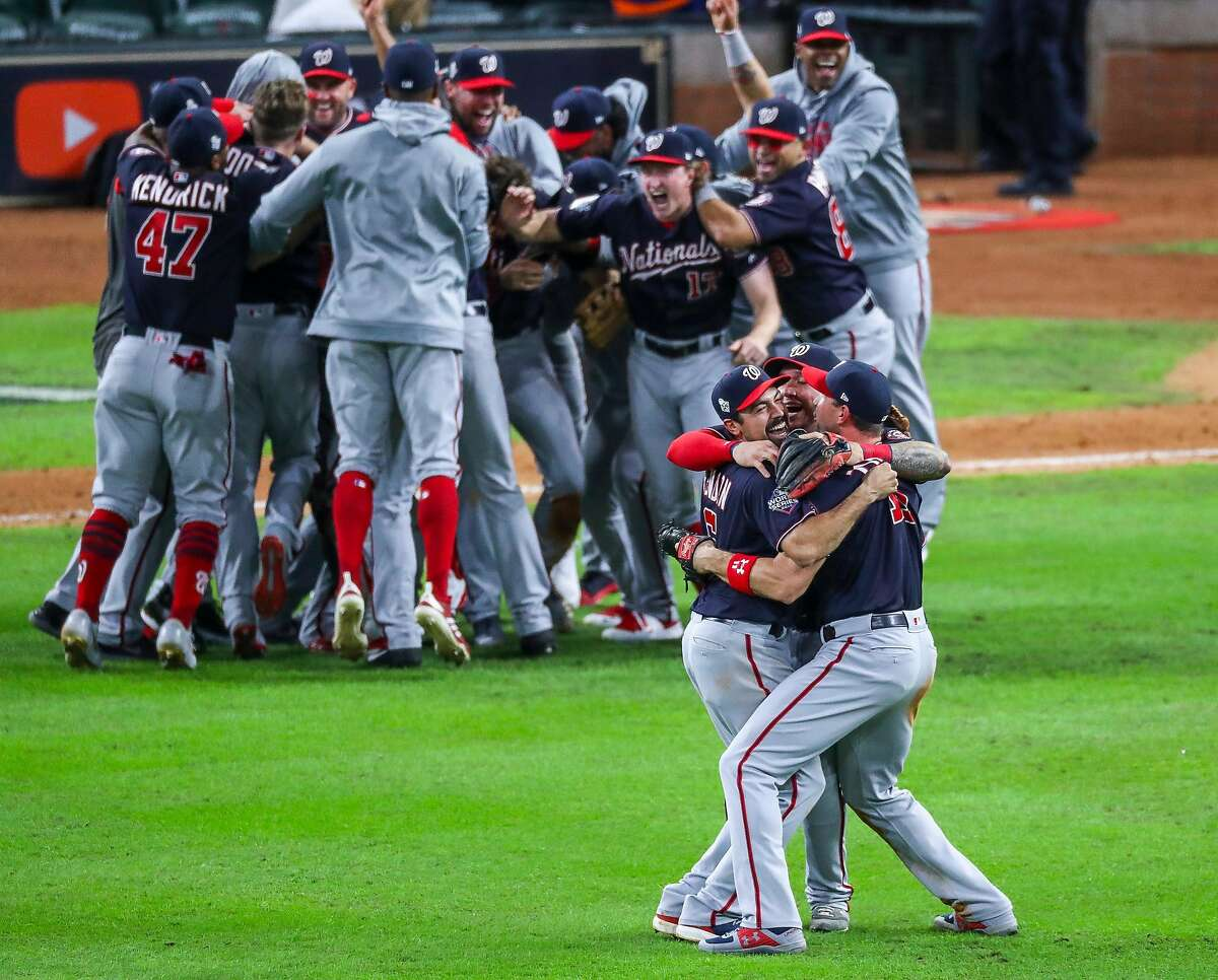 Washington Nationals third baseman Anthony Rendon (6) is hugged by his teammates as the Nationals celebrate their win of Game 7 of the World Series at Minute Maid Park on Wednesday, Oct. 30, 2019, in Houston.