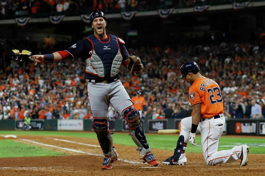 Washington Nationals catcher Yan Gomes celebrates after Houston Astros' Michael Brantley strikes out to end Game 7 of the baseball World Series Wednesday in Houston. Photo: Matt Slocum, STF / Associated Press / Copyright 2019 The Associated Press. All rights reserved.