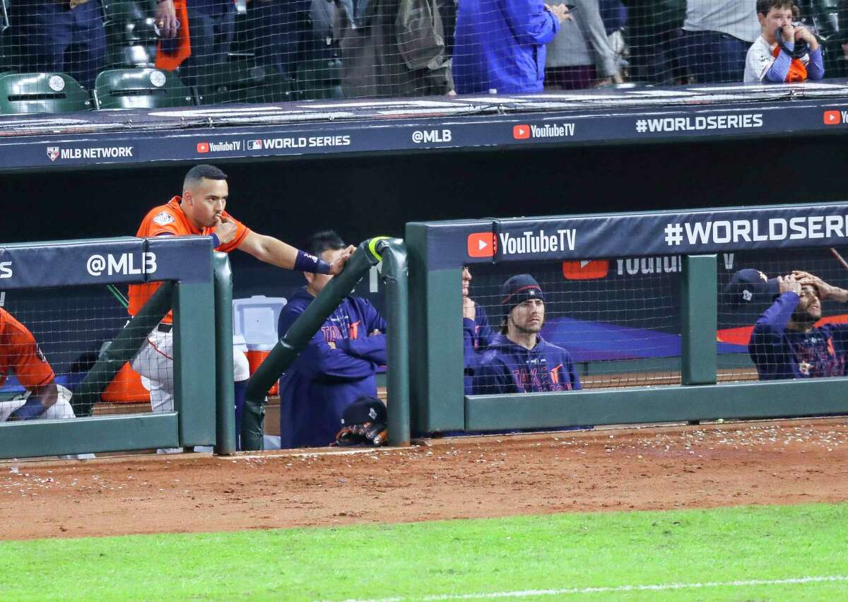 Houston Astros shortstop Carlos Correa (1) watches from the dugout at the end of Game 7 of the World Series at Minute Maid Park on Wednesday, Oct. 30, 2019, in Houston.