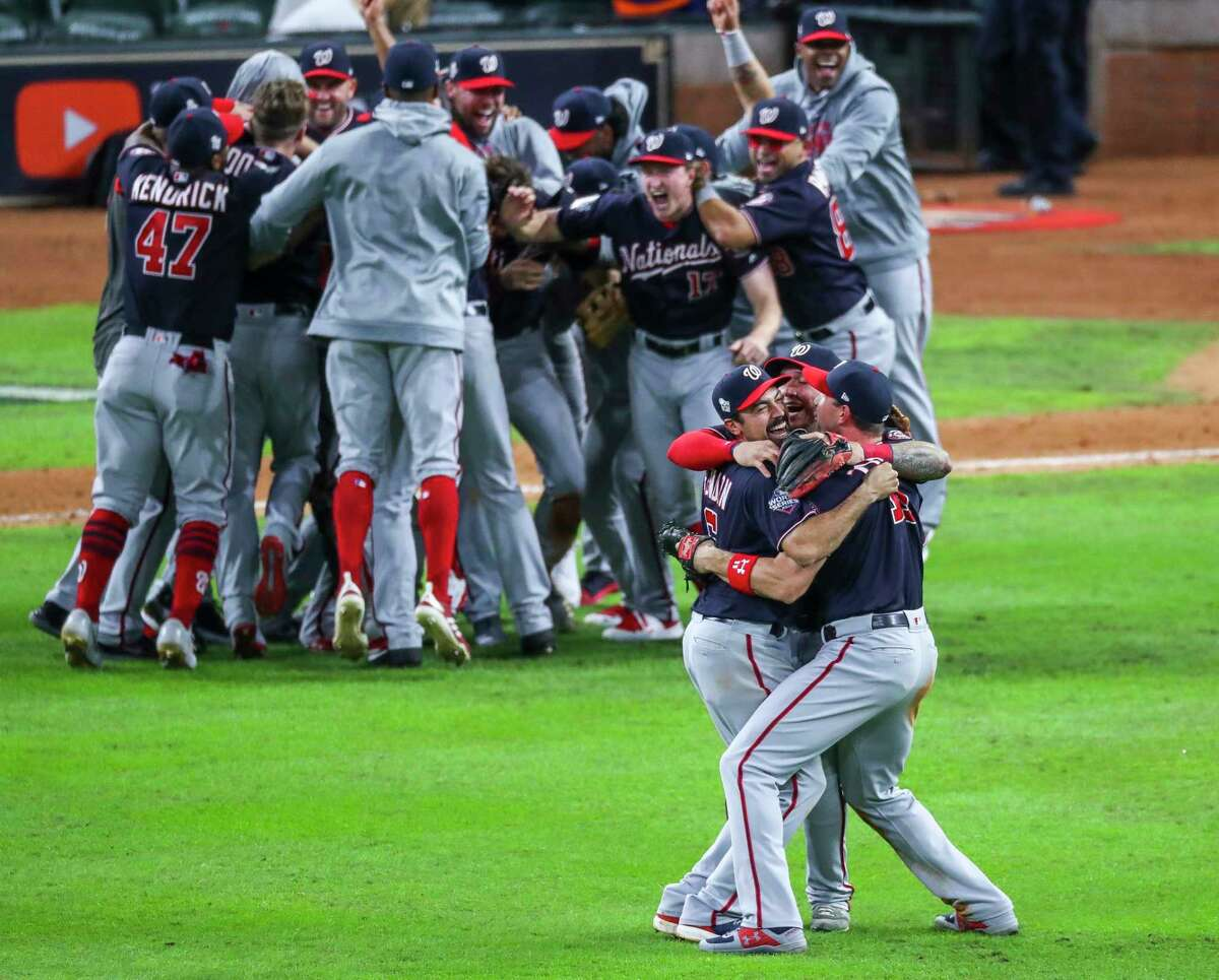 Washington Nationals third baseman Anthony Rendon (6) is hugged by his teammates as the Nationals celebrate their win of Game 7 of the World Series at Minute Maid Park on Wednesday, Oct. 30, 2019, in Houston. 3. No touching Part of reducing the spread is reducing the mirth, and the MLB will not allow teammates to engage in close-quarters celebrations such as dapping or hugging during games. Contact before games will not be allowed, either.