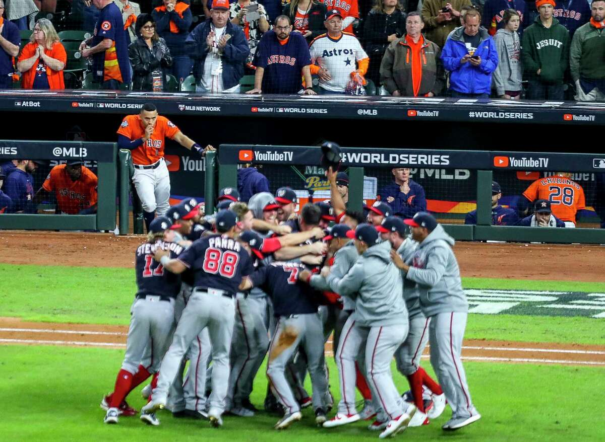 Houston Astros shortstop Carlos Correa (1) watches as the Nationals celebrate their World Series title at the end of Game 7 of the World Series at Minute Maid Park on Wednesday, Oct. 30, 2019, in Houston.