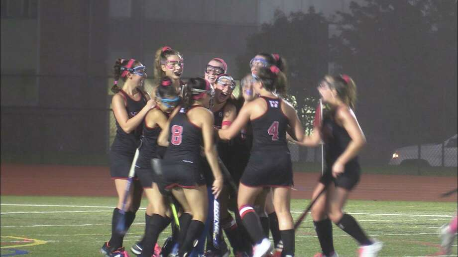 Members of the Warde field hockey team celebrate during their 2-1 win over Ludlowe Wednesday to earn the final berth in the FCIAC tournament. Photo: Will Aldam / Hearst Connecticut Media