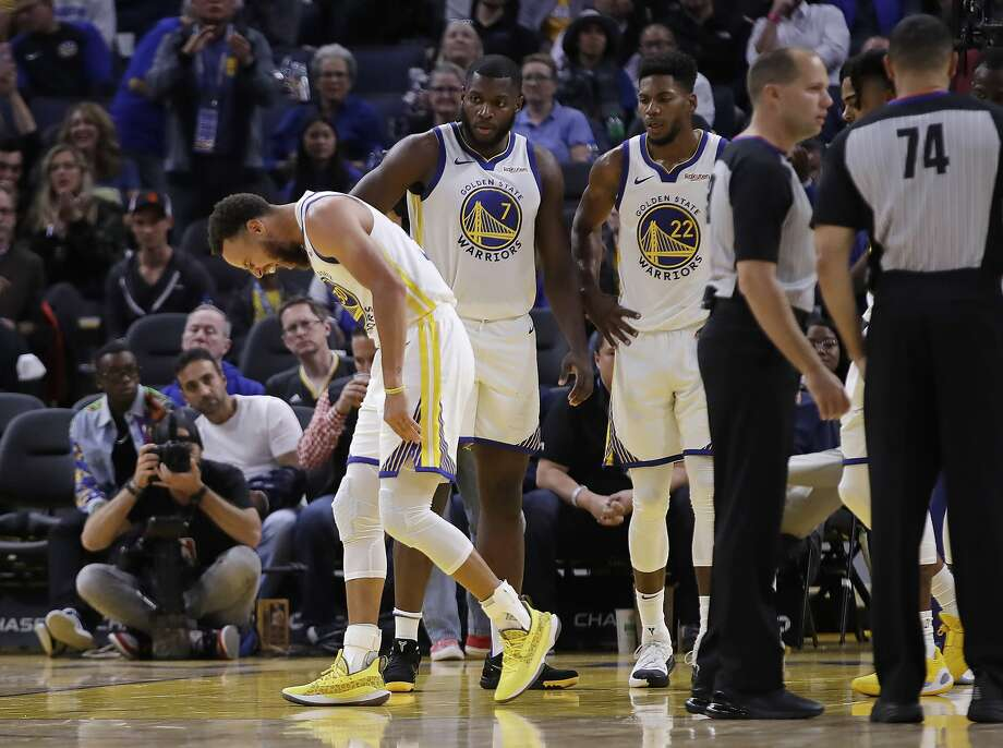 Golden State Warriors' Stephen Curry, left, grimaces after Phoenix Suns' Aron Baynes fell onto him during the second half of an NBA basketball game Wednesday, Oct. 30, 2019, in San Francisco. Curry left the game.  Photo: Ben Margot / Associated Press
