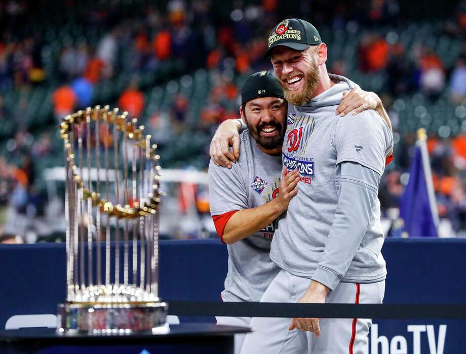 Washington Nationals pitcher Stephen Strasburg (37) and Washington Nationals catcher Kurt Suzuki (28) hug as they are presented the Commissioners Trophy after the Nationals win Game 7 of the World Series at Minute Maid Park on Wednesday, Oct. 30, 2019, in Houston. Photo: Brett Coomer, Staff Photographer / © 2019 Houston Chronicle