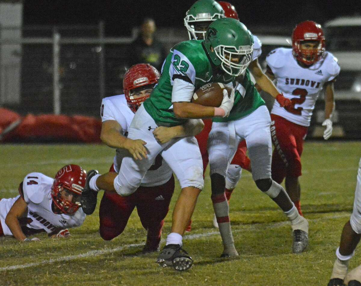 Floydada's Matthew Morales attempts to break off from a Sundown tackler on a run play during their District 2-2A Division I football game at Wester Field earlier this season.