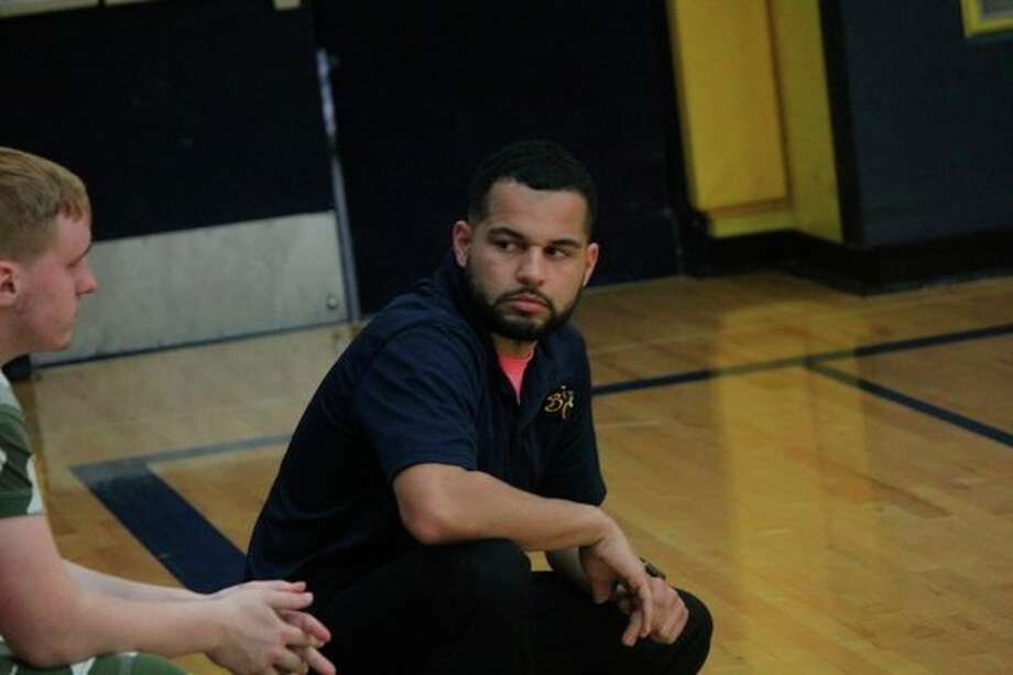 Baldwin volleyball coach Duane Roberts confers with assistant Jesse Pancio during a match. (Star file photo)