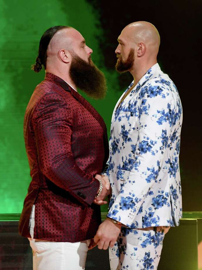 WWE Superstar Braun Strowman, left, and lineal heavyweight boxing champion Tyson Fury face off during the announcement of their match at a WWE news conference at T-Mobile Arena on Oct. 11, 2019 in Las Vegas, Nev. Strowman will face Fury and WWE champion Brock Lesnar will take on former UFC heavyweight champion Cain Velasquez at the WWE's Crown Jewel event at Fahd International Stadium in Riyadh, Saudi Arabia on Oct. 31, 2019. Photo: Ethan Miller / Getty Images / 2019 Getty Images