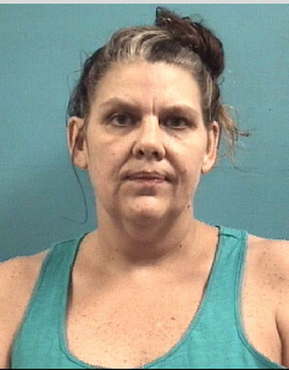 Dawn M. Taylor is charged with theft related tomid-July