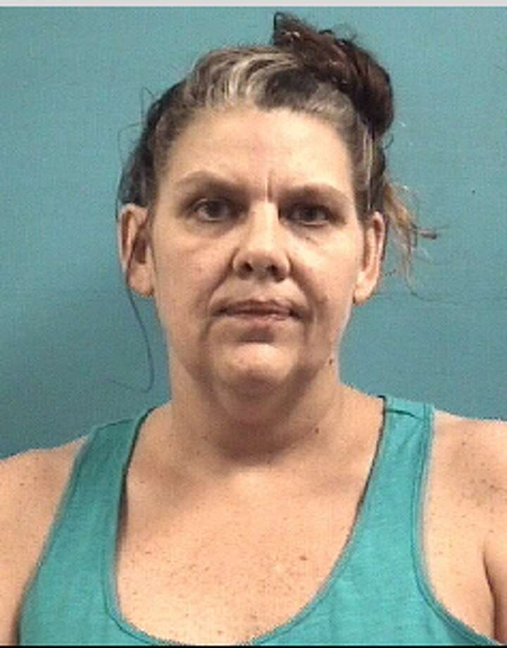 """Dawn M. Taylor is charged with theft related tomid-July """"porch pirate"""" thefts in the 2500 block of Creeks Edge Drive and 1800 block of Oak Lodge Drive in Pearland, police reported. Photo: Pearland Police Department"""