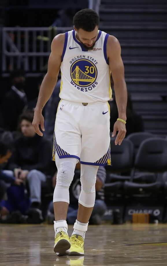 Golden State Warriors' Stephen Curry looks at his left hand after Phoenix Suns' Aron Baynes fell onto him during the second half of an NBA basketball game Wednesday, Oct. 30, 2019, in San Francisco. Curry left the game. (AP Photo/Ben Margot) Photo: Ben Margot, Associated Press