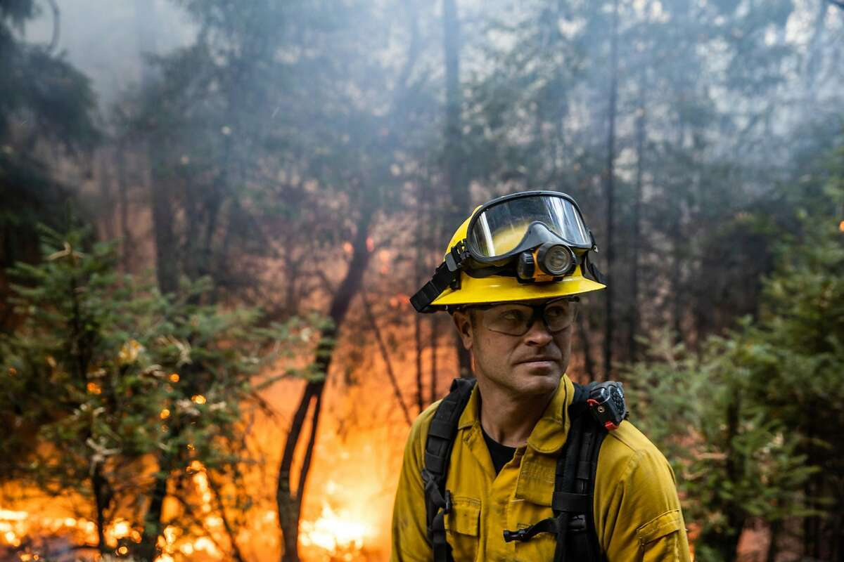 Yocha Dehe firefighter Charlie Jahelka watches for spot fires behind a containment line of the Kincade fire in Kellogg, Calif. on Wednesday, Oct. 30, 2019.
