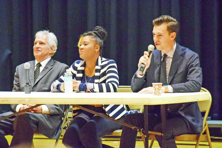 Mayoral candidates, from left, Common Council Minority Leader Sebastian N. Giuliano, activist Valeka Clarke (a write-in candidate) and Wesleyan University graduate Ben Florsheim take questions during a forum Tuesday night. Photo: Michelle France Photo