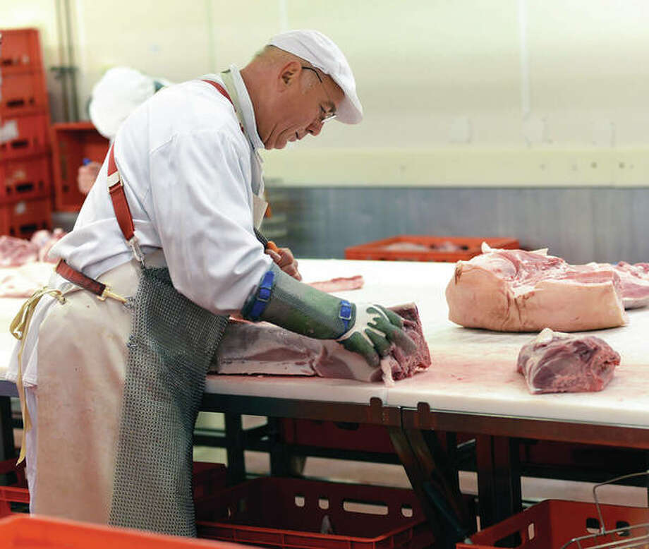 Pig carcasses are divided and processed. Photo: Getty Images