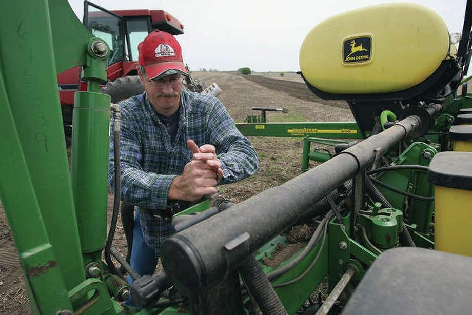 Dan Meyer prepares his planter before planting corn on his family's farm near Hampshire. Photo: Scott Olson | Getty Images