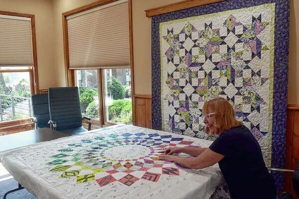 Linda Focareto of Mount Pleasant, Wisconsin, works on a quilt during a retreat at Sprague's Kinderhook Lodge. Sprague's Kinderhook Lodge is owner Andy Sprague's effort to diversify his family farm's business.