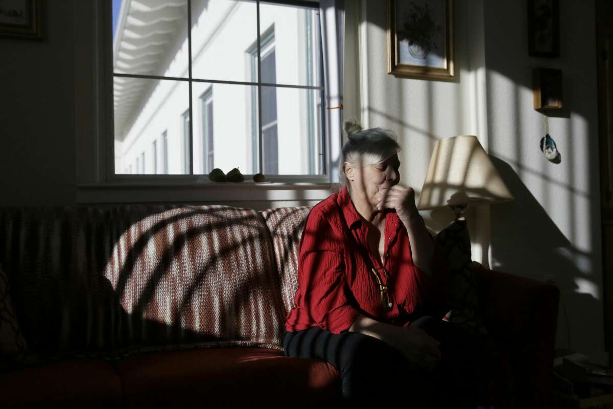 Pamela Zuzak, 70, reflects on her experiences of being stranded in the dark during the power blackouts at the Villas at Hamilton housing complex for low income seniors Wednesday, Oct. 30, 2019, in Novato, Calif. Pacific Gas & Electric officials said they understood the hardships caused by the blackouts but insisted they were necessary. (AP Photo/Eric Risberg)