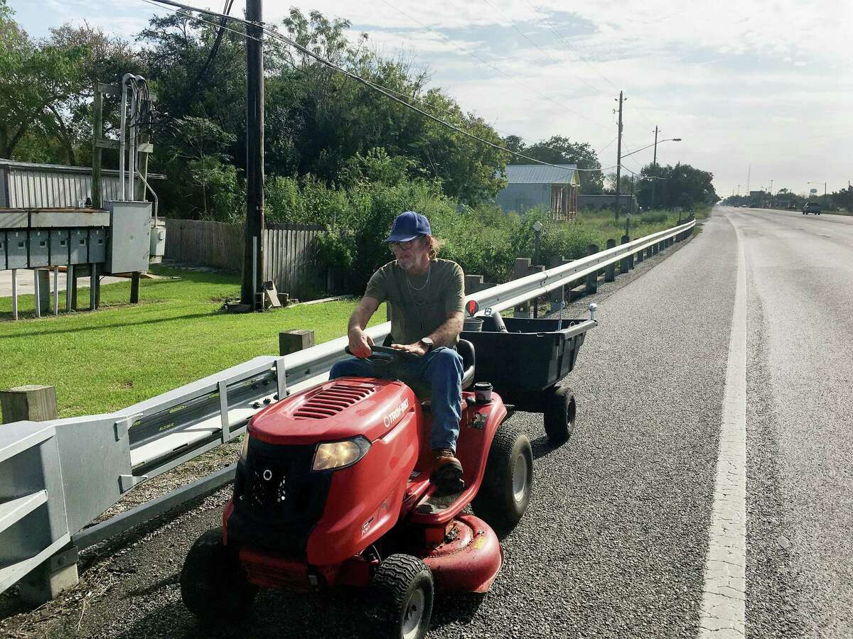 """""""It looks old. But lots of people have older-style cars."""" A combination of medical and legal issues has prevented Damon Burns from holding a driver's license for more than a decade, so he relies on his lawnmower to get around Santa Fe."""