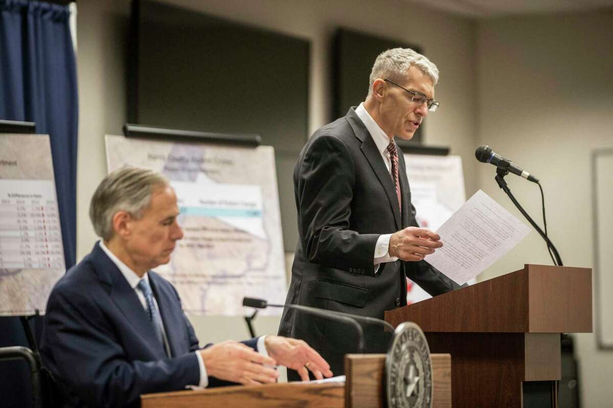 Steve McCraw, right, director of the Texas Department of Public Safety joined Texas Governor Greg Abbott, left, to announce a new plan against gang violence, Monday, April 10, 2017, in Houston. ( Marie D. De Jesus / Houston Chronicle )