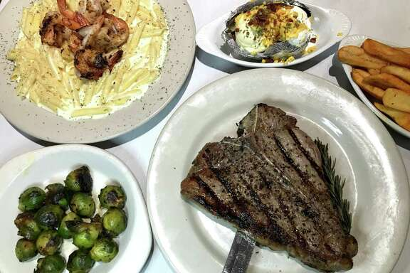 Shrimp Alfredo, a porterhouse steak and sides from Hoffman's Steakhouse
