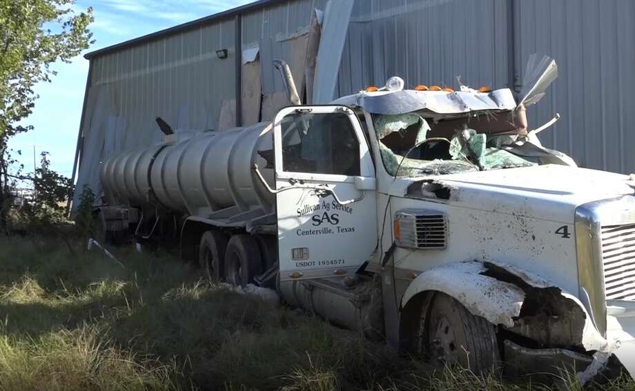 The driver of an 18-wheeler feel asleep at the wheel while traveling southbound on Interstate 45Halloween morning and crashed through a Willis building after losing control of the vehicle. Photo: Scott Engle/Montgomery County Police Reporter