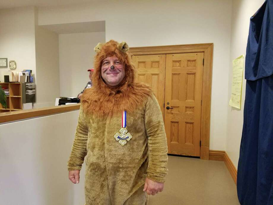 New Canaan Director of Public Works Tiger Mann boldly confronts New Canaan town boards with NCTV cameras rolling, but he dressed as the Cowardly Lion for Halloween. Photo: Grace Duffield / Hearst Connecticut Media Photo: Grace Duffield / Hearst Connecticut Media