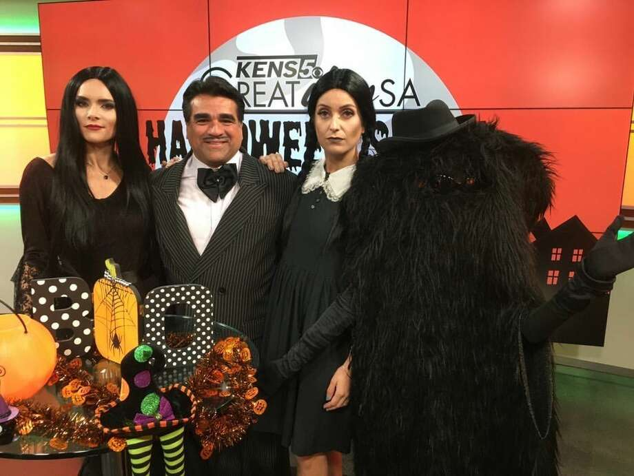 "The ""Great Day SA"" team rocked the Addams Family theme. From left to right: Host Cristina Blackwell as Morticia, co-host Paul Mireles as Gomez, co-host Roma Villavicencio as Wednesday and associate producer Victoria de Leon as Cousin It. Photo: Roma Villavicencio"