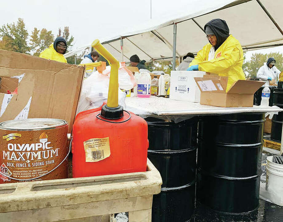 Workers process household hazardous waste at an event hosted by Madison County Planning and Development, SIUE and the Illinois Environmental Protection Agency. Approximately 30,247 pounds of household hazardous waste was collected at the event, held at SIUE.