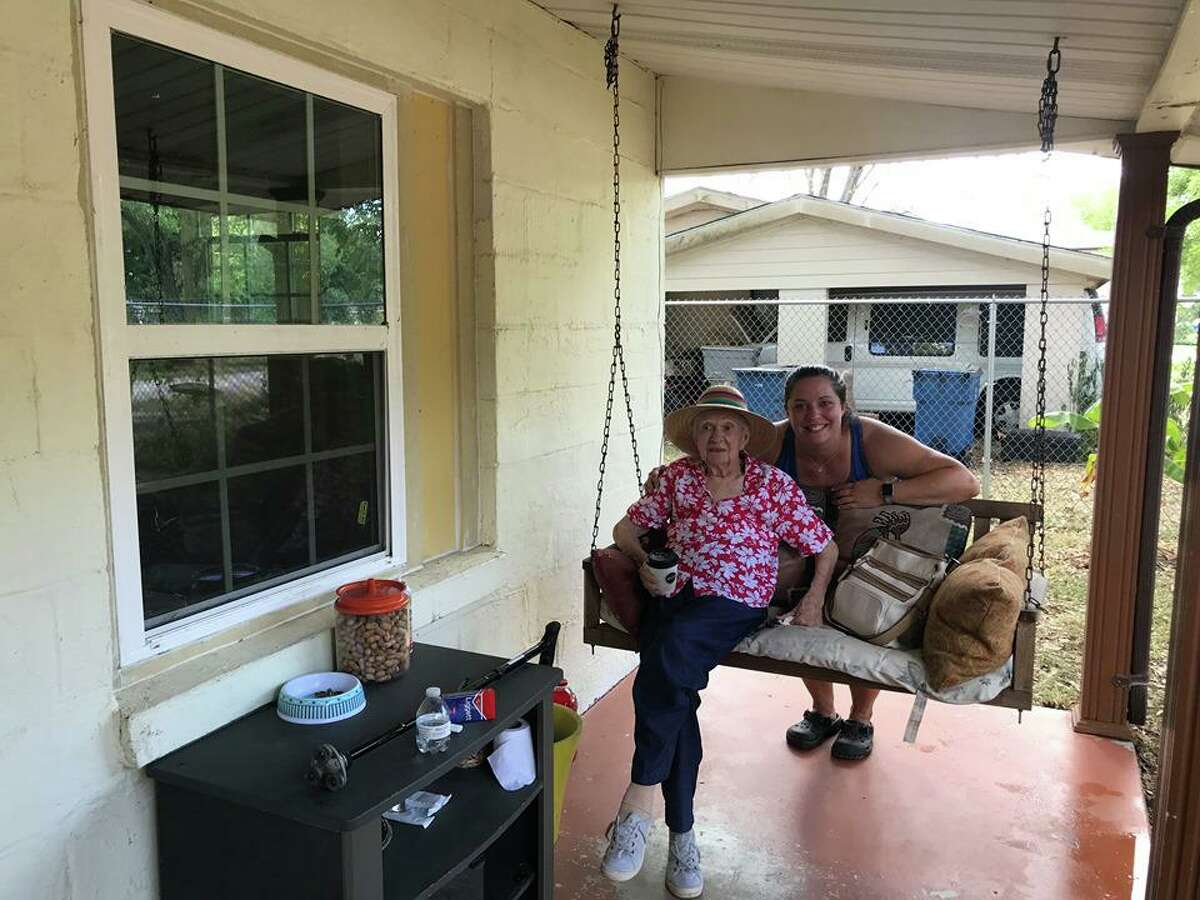 Ann Zanfradino (left) and Adrienne Davitz relax together after moving Zanfradino back into her home.