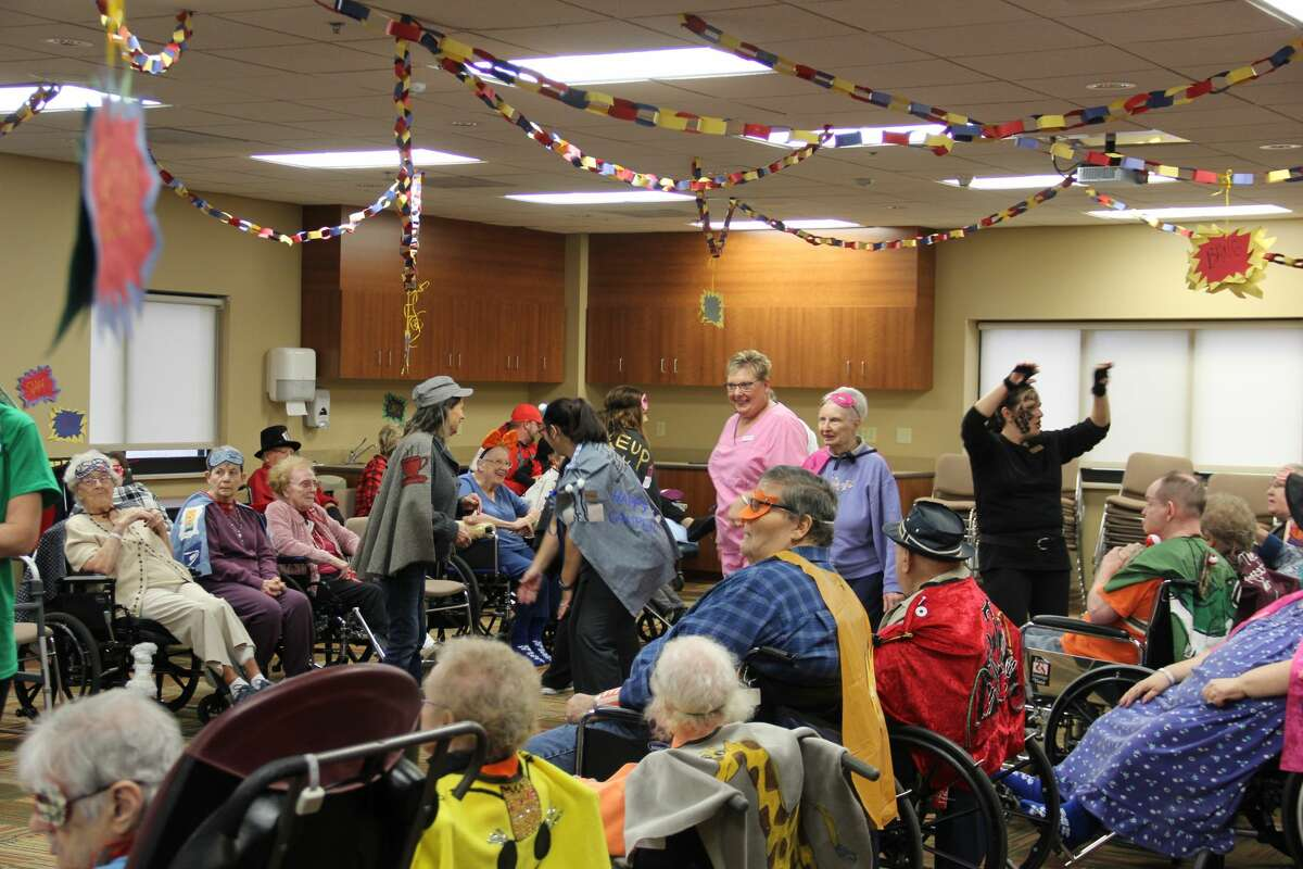 Residents of the Huron County Medical Care Facility dressed up as superheroes for Halloween. Their costumes are based on their personalities and interests.