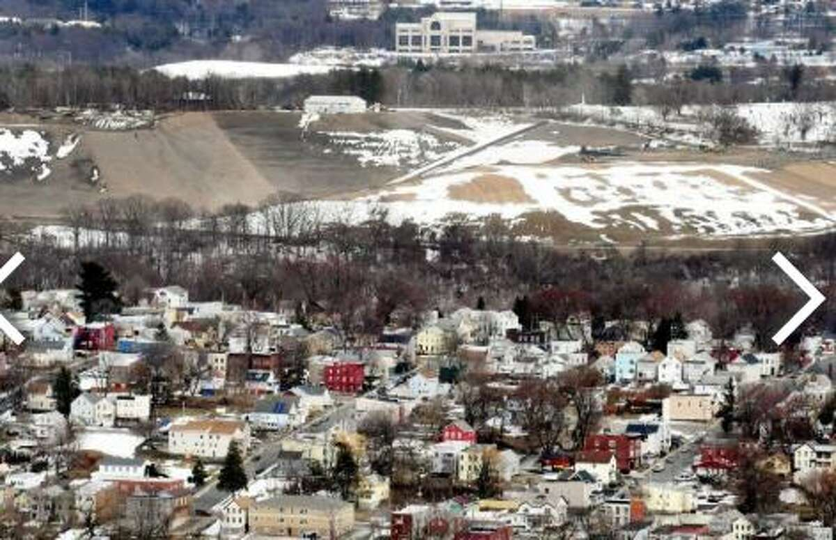 The Dunn C&D Landfill is visible above city houses on Tuesday, March 20, 2018, in Rensselaer, N.Y. In 2016, the landfill took in 407,975 tons of debris
