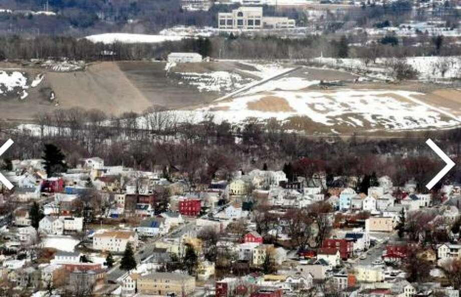 The Dunn C&D Landfill is visible above city houses on Tuesday, March 20, 2018, in Rensselaer, N.Y. In 2016, the landfill took in 407,975 tons of debris Photo: Will Waldron/Times Union
