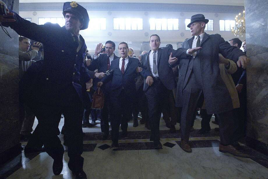 """This image released by Netflix shows Al Pacino, center left, and Robert De Niro, center right, in a scene from """"The Irishman."""" (Netflix via AP) Photo: Associated Press"""