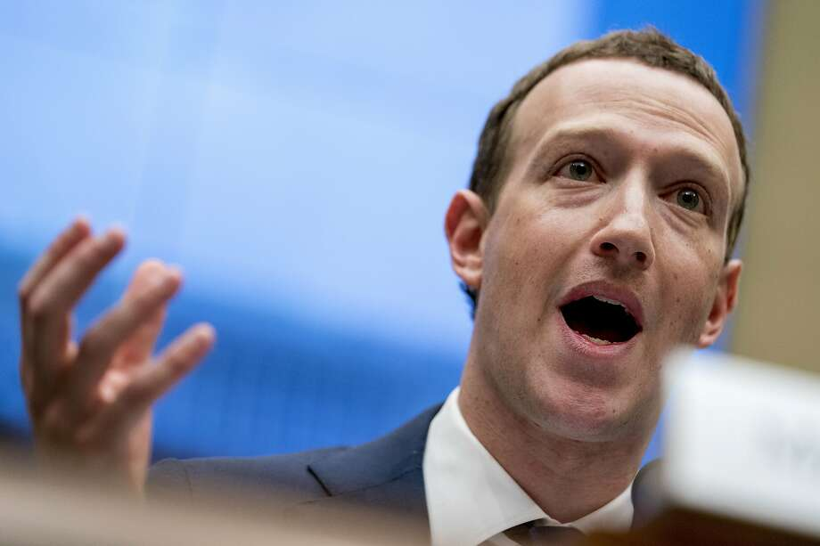 """FILE - In this April 11, 2018, file photo Facebook CEO Mark Zuckerberg testifies before a House Energy and Commerce hearing on Capitol Hill in Washington. Twitter's ban on political advertising is ratcheting up the pressure on Facebook and Zuckerberg to follow suit. Zuckerberg doubled down on Facebook's approach in a call with analysts Wednesday, Oct. 30, 2019, he reiterated Facebook's stance that """"political speech is important."""" (AP Photo/Andrew Harnik, File) Photo: Andrew Harnik / Associated Press 2018"""