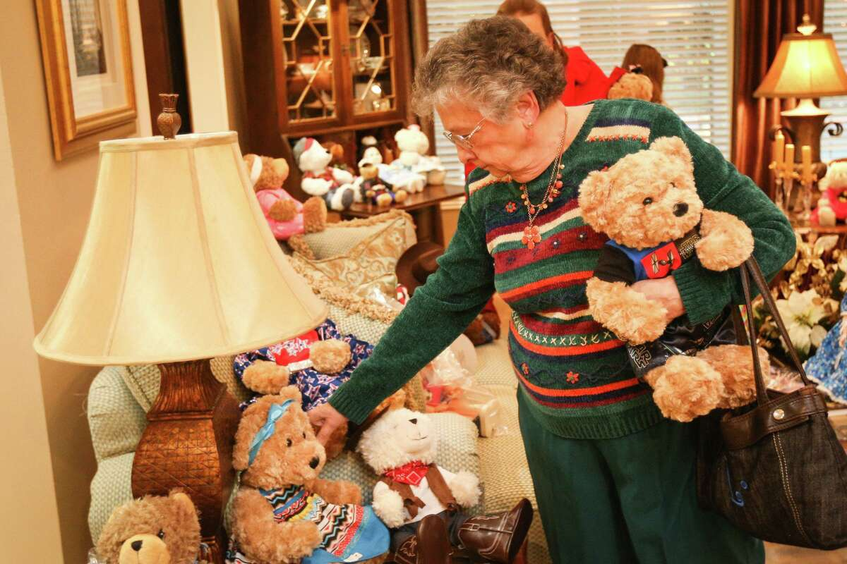 Conroe resident Ladoris Cates browses dressed up dolls and bears during the Salvation Army's Doll and Bear Tea event in 2016 at the Crockett home in Conroe. This year's Doll Tea is Sunday, Dec. 8, at the home of Dr. and Mrs. Howard Crockett.