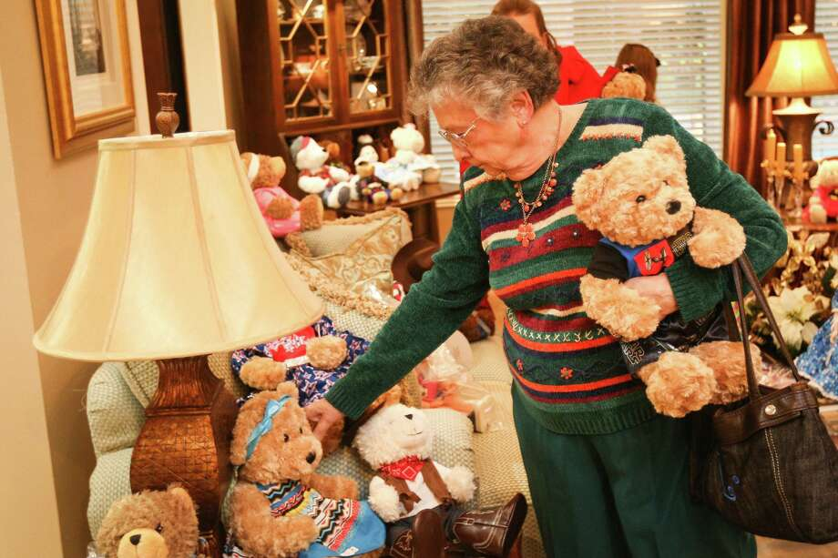 Conroe resident Ladoris Cates browses dressed up dolls and bears during the Salvation Army's Doll and Bear Tea event in 2016 at the Crockett home in Conroe. This year's Doll Tea is Sunday, Dec. 8, at the home of Dr. and Mrs. Howard Crockett. Photo: Michael Minasi, Staff / Houston Chronicle / © 2016 Houston Chronicle