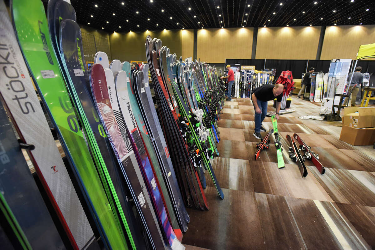 Employees with Potter Brothers Ski and Snowboard Shop out of Kingston set up their display of ski and snowboard equipment for the Northeast Ski and Craft Beer Showcase at the Albany Capital Center on Thursday, Oct. 31, 2019, in Albany, N.Y. The event begins Friday afternoon and runs through Sunday. The Saratoga Eagle Craft Beer Garden will feature breweries, wineries and cideries. (Paul Buckowski/Times Union)