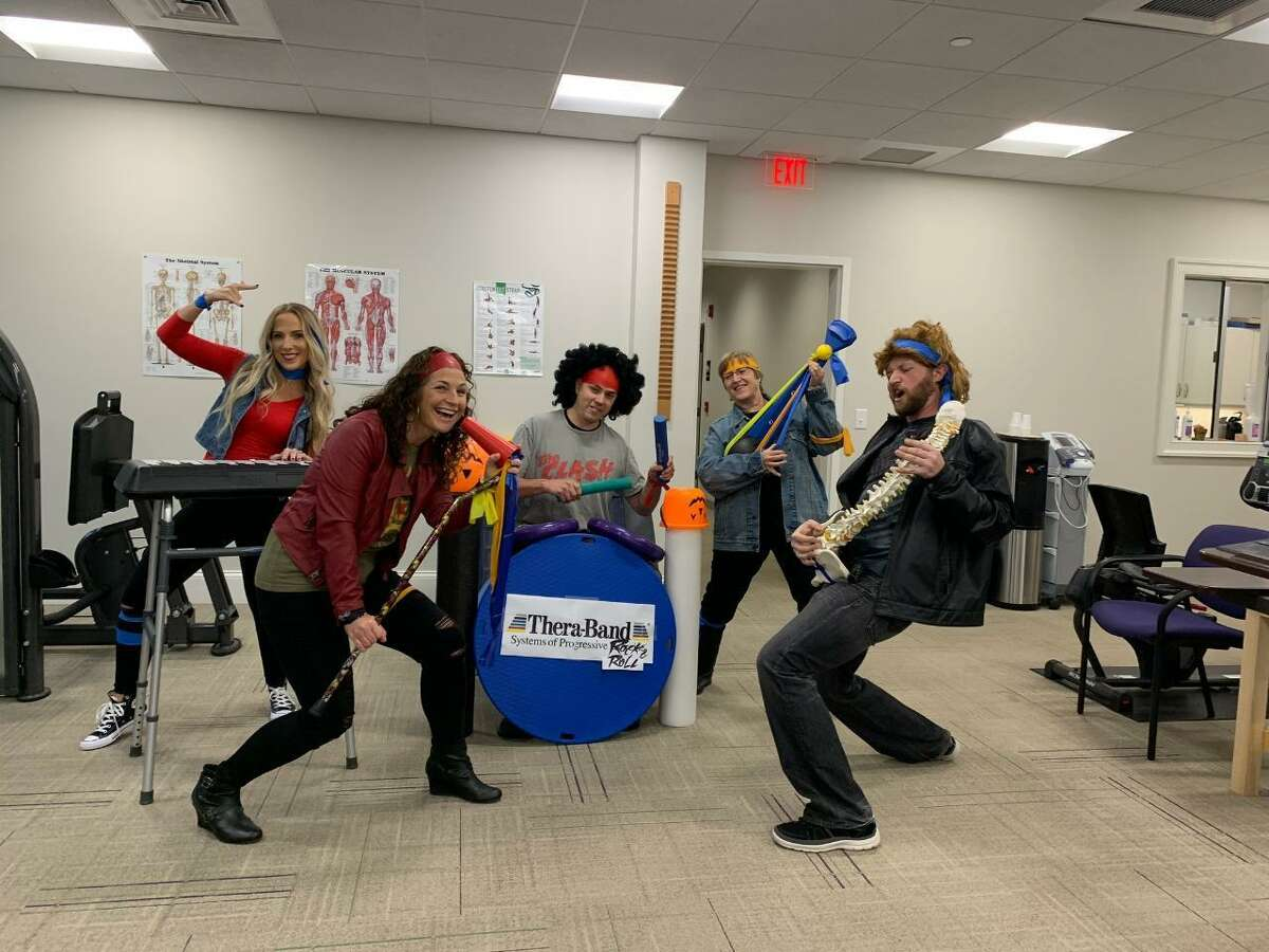 Greetings and Happy Halloween from the team at RVNAhealth Rehabilitation & Wellness Center, aka The Therabands. Yes, they're all practicing clinicians, but that doesn't mean that they can't rock with the best of them. Pictured is Sarah Triano, OTR; Casey Sarmiere, MSPT; Jeff Panepento, MSPT; Peggy Marlin, Rehab Tech; and Will Rowe, PTA. Missing from the photo is Gigi Weiss, MSPT, Band Manager. Learn more at rvnahealth.org.
