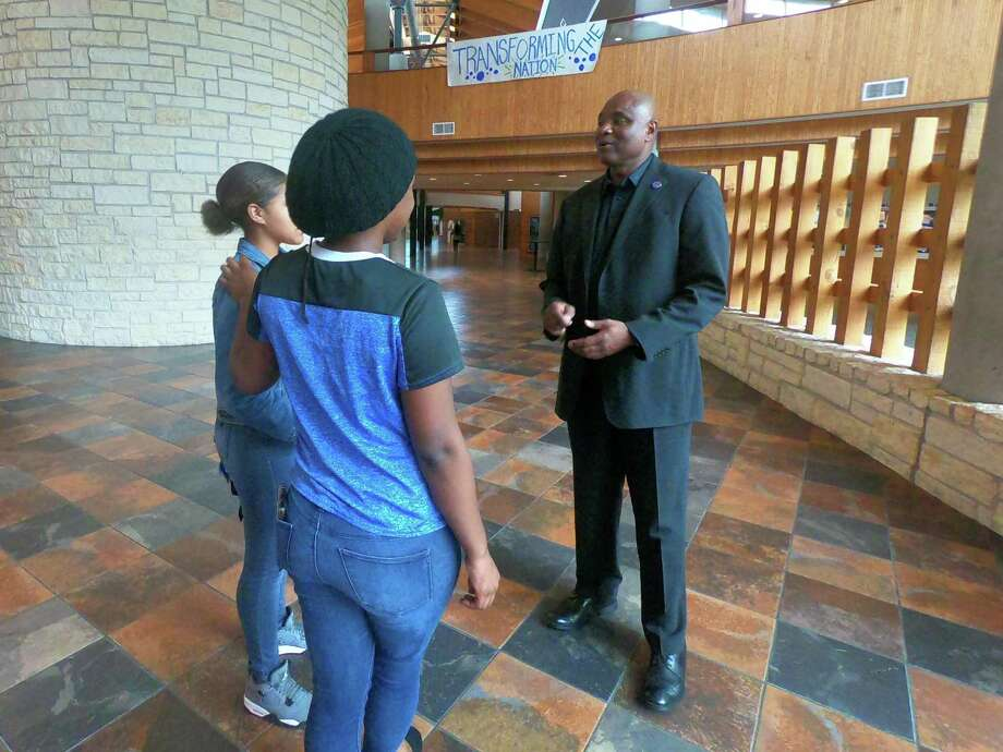 Principal Alonzo Reynolds III speaks with two of his students at Dekaney High School in Spring ISD. Photo: Courtesy Of Spring ISD