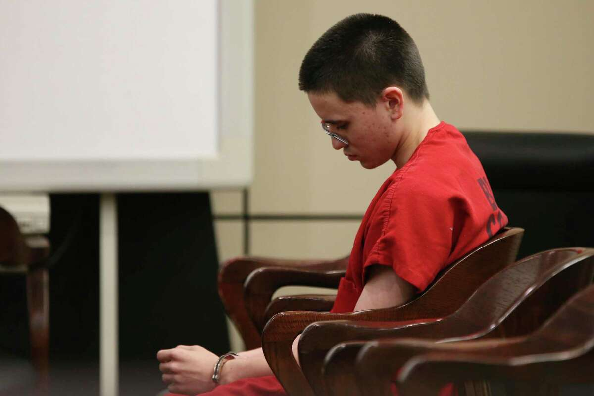 Matthew Dempsey, 18, sits In the Bexar County 437th State District Court before pleading guilty to murder charges, Thursday, Oct. 31, 2019. Dempsey killed his mother, Mary Helen Dempsey, 53, in April of this year. Dempsey was originally charged with capital murder charges. He will receive a 42-year prison sentence after his co-defendant, Daniel Saucedo, 18, is tried. The pair are accused of killing Dempsey with a baseball bat.
