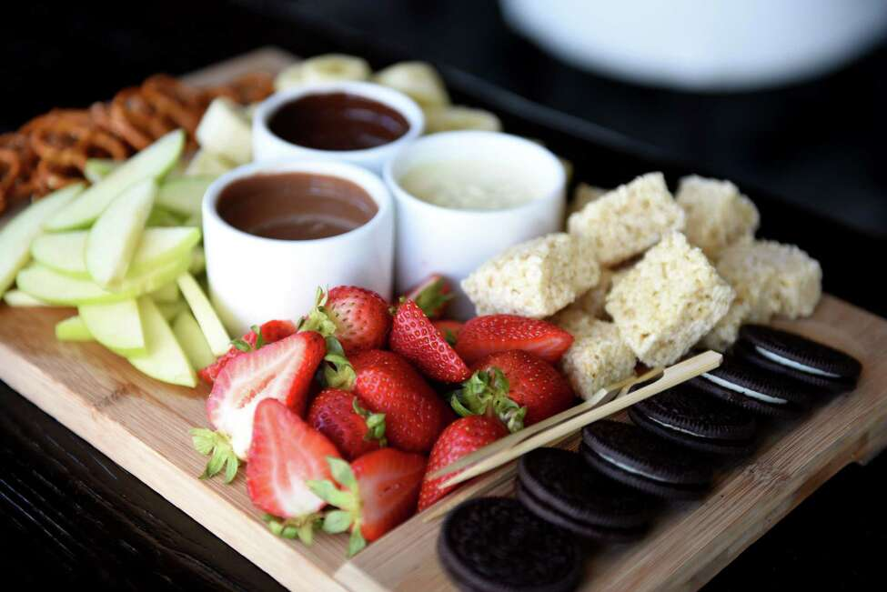 Chocolate fondue flight; dark and white chocolate fondue served with apples, bananas, rice crispy treats, Oreos, pretzels, strawberries from Shaker & Vine on Thursday, Aug. 29, 2019, at Mohawk Harbor in Schenectady, N.Y. (Will Waldron/Times Union)