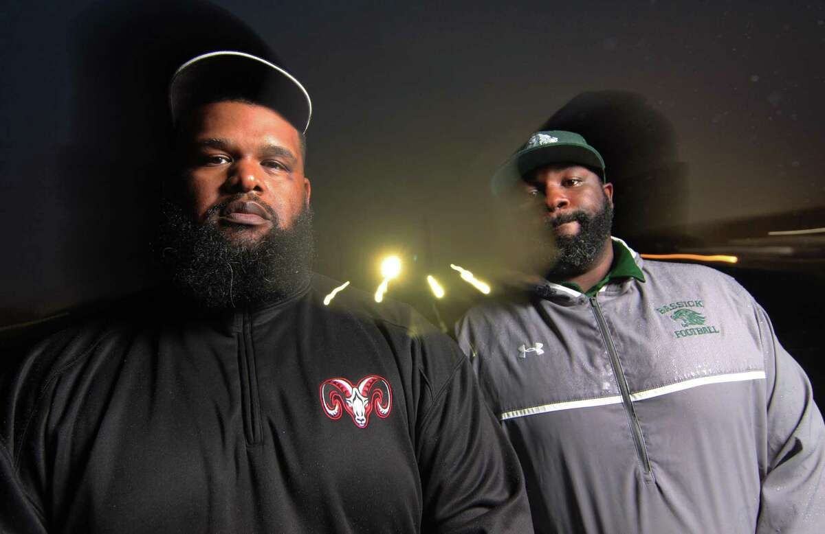 Bridgeport Central football coach Derrick Lewis Bassick, left, and Bassick football coach Desmond Lymon pose together at West Haven High School during last season. Lewis has stepped down after two seasons.